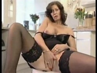 Mature Lady strips and Mastubates with Pink Dildo